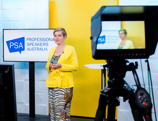 photo of woman in yellow in front of tv with words PSA in background