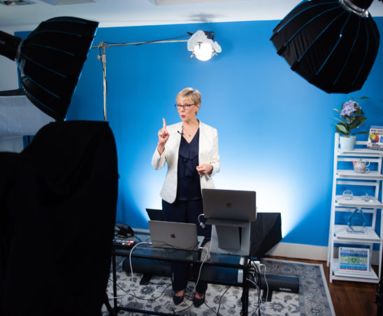 photo of Kim in front of blue screen