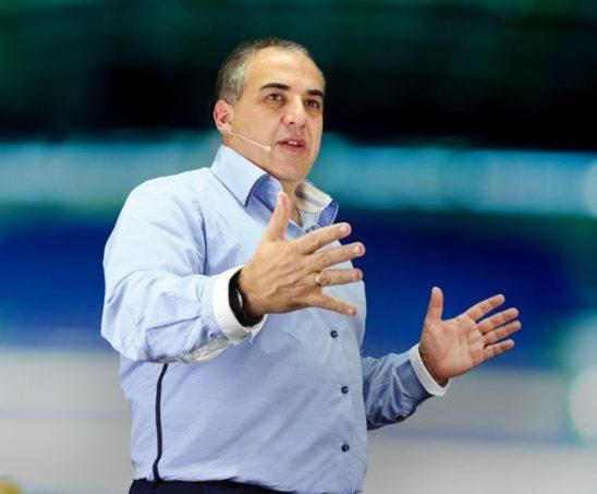 Rael Bricker speaking on stage